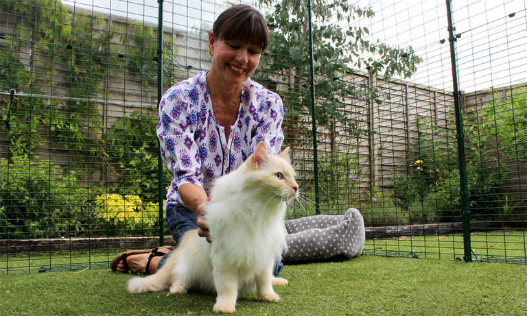 3x4x2 Outdoor Cat Run - woman sat inside with her ragdoll cat
